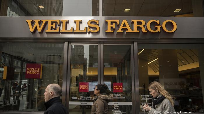 Pedestrians pass in front of a Wells Fargo & Co. bank branch in New York, U.S., on Wednesday, Jan. 11, 2017. Wells Fargo & Co. is scheduled to release earning figures on January 13. Photographer: Victor J. Blue/Bloomberg