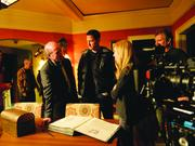 Director Aaron Lipstadt consults with actors Sasha Roiz and Claire Coffee on Portland set of NBC's Grimm during the filming of an episode for the show's sixth and final season.