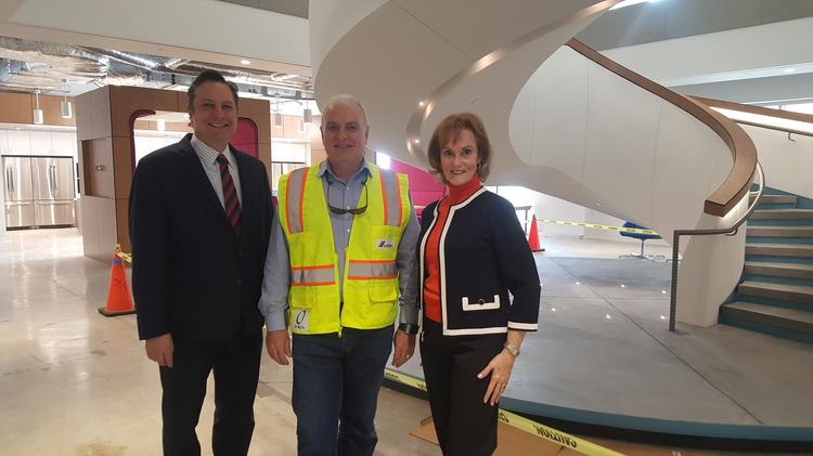 Cresa principal Stephen Heal, Cemex's director of real estate Ed Prins and Cresa principal Sue Rogers at Cemex's new space in 10100 Katy Freeway.