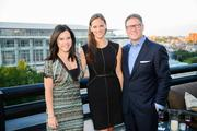 UrbanDaddy made a rooftop stop in D.C. on its three-city Evening of Rediscovery tour, launching a new digital rollout on its website that encourages the discovery of hidden gems in each city. The event was held on Sept. 5 on the rooftop at the Renaissance Downtown. From left, Vanessa Rodriguez of Federal Realty, Whitney Bossin of Hines and Tim Lowery of CityCenterDC.