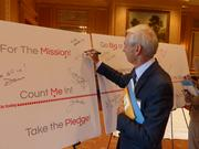 Dave Kay of Cross-Country Consulting takes the pledge to help raise $3 million.