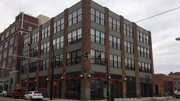 Growing architecture engineering firm woolpert opens otr for Architecture and engineering firms