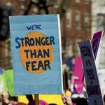 What women said — and the signs they held — at massive marches last weekend