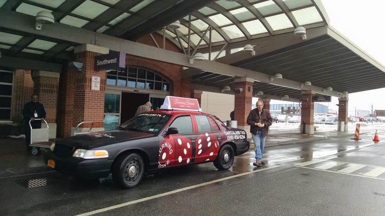 3af2238afe6f A Capitaland Taxi at the Albany International Airport with an ad for Turning  Stone Resort Casino