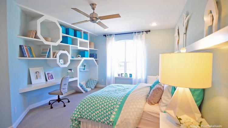 Homes with light blue bedrooms sold on average for about $1,856 more than homes with other colors, according to Zillow. Shown here: A secondary bedroom in Toll Brothers' model home at Woodson's Reserve.