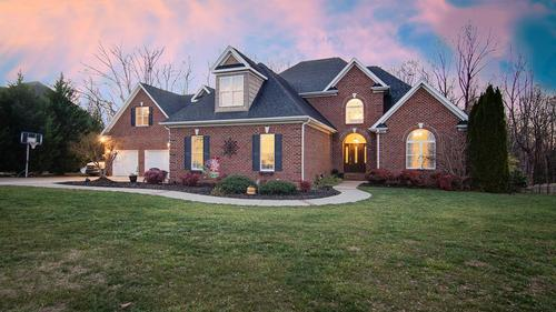 Stunning Brick Home Nestled in Serenity Pointe Neighborhood