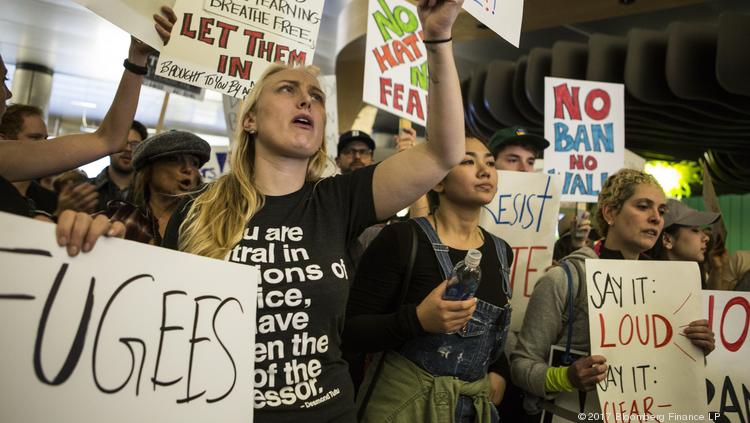 Demonstrators hold signs and chant inside Los Angeles International Airport protesting President Donald Trump's executive order blocking visitors from seven predominantly Muslim nations on Jan. 29, 2017.