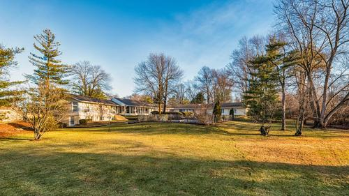 Step out of the ordinary and into this Mid-Century Sprawling Ranch on 1.5 Acres!