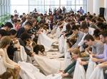 Northwestern medical students lay down white coats by the hundreds in ACA protest
