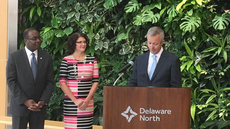 From left, Mayor Byron Brown and Olmsted Parks Executive Director Stephanie Crockatt, with Lou Jacobs, co-CEO at Delaware North, which is granting $100,000 per year for the next three years.