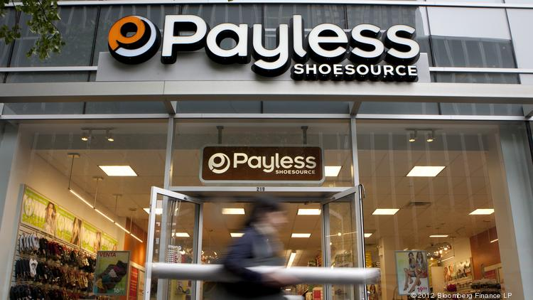 A pedestrian passes in front of a Payless ShoeSource store in New York in May 2012.
