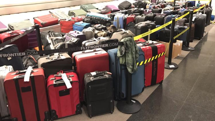 Wayward baggage belonging to Frontier Airlines passengers piled up at DIA during December's snowstorm.