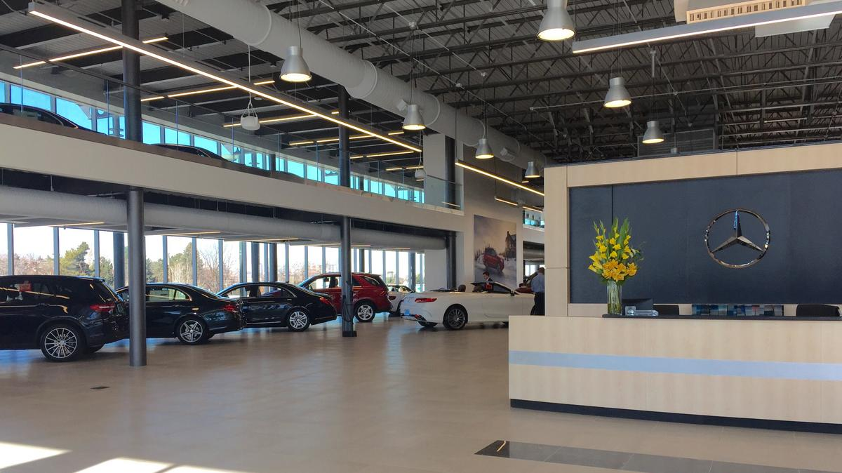 Sonic automotive spends 28 million on luxury dealerships for Murray motors denver mercedes