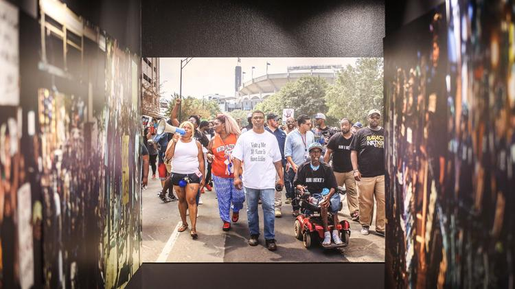 The new K(NO)W Justice K(NO)W Peace exhibition at Levine Museum of the New South, which opens Friday, explores the impact of police-involved shootings in Charlotte and across the country with photos, stories and footage.