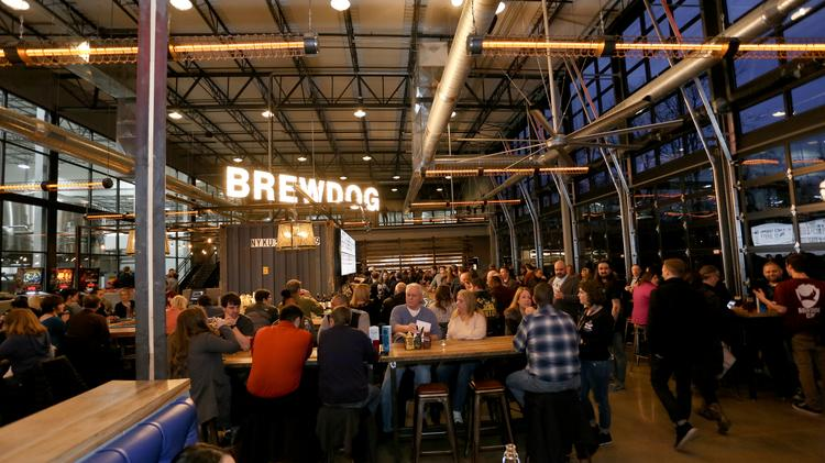 A crowd enjoying some beer at BrewDog's DogTap taproom and restaurant in Canal Winchester.