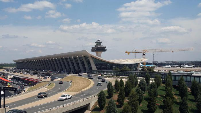 Cares drive into Dulles International Airport, in Dulles, Virginia, June 20, 2007. Photographer: Dennis Brack/Bloomberg News