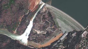 An image from DigitalGlobe's WorldView-4 satellite taken Feb. 14 shows an eroding spillway of the Oroville Dam in California. A day earlier, flooding of the spillway off the dam, the U.S.'s tallest, prompted the evacuation of 188,000 people downstream.