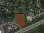 Auto dealer sells land to expand park