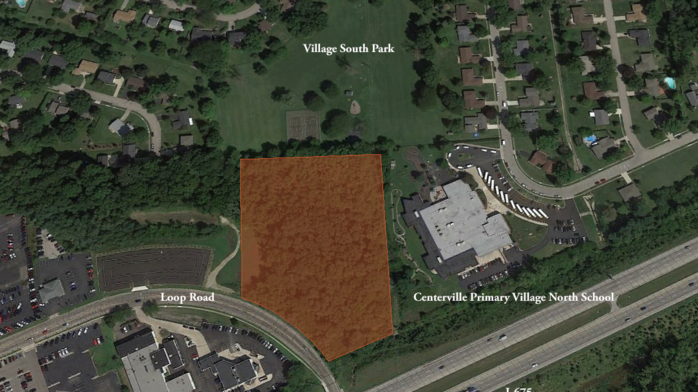 Auto dealer sells land to expand park