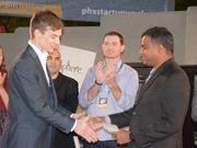 InfluenceLogic CEO Joel Robinson wins a surprise $25,000 check from RezTech at the Phoenix Startup Week's inaugural Street Pitch competition Feb. 22, 2017.