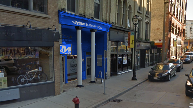 Illinois printing company plants flag in downtown Milwaukee