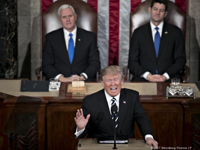President Donald Trump speaks as Vice President Mike Pence and House Speaker Paul Ryan, (R-Janesville) listen during a joint session of Congress Tuesday.