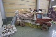 Turner Construction's entry in the Cincinnati Canstruction project depicts a cement truck. It is on display at the Aronoff Center for the Arts.