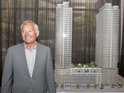 Nat Bosa, president of Bosa Development, is pictured by a model of the Insignia condo project that is under construction in downtown Seattle.