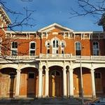 Historic high school owned by Sojourner-Douglass College sold in foreclosure auction