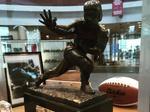 Sports memorabilia seller admits to fake Heisman Trophy scam