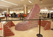 A shoe constructed using cans of food stands in the downtown Macy's store.
