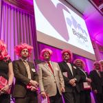 Business bigwigs don pink wigs to help raise money to fight breast cancer: Slideshow