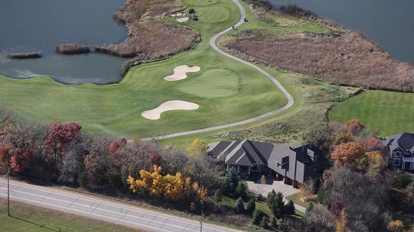 Exquisite Custom Build on Signature Hole 13 of Legends Golf Course!