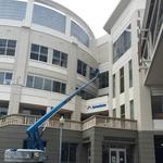 ServiceMaster signs going up Downtown
