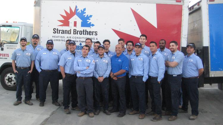 Strand Brothers Service Experts Has Acquired Air Conditioning Pictured Are Members Of The