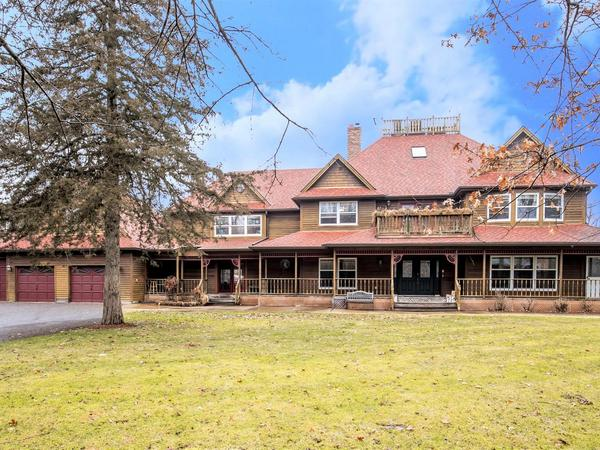 Beautiful Victorian on 1.3 Acres of Privacy with 300+ Feet of Frontage on the Rum River