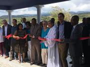Mercy Health CEO John Starcher (in blue shirt, second from left) was among representatives of the Cincinnati-based system who helped open a hospital in Haiti this month.