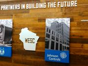 Johnson Controls image and brand was added to a wall at the Bucks Schlitz Park offices displaying major business partners in the new arena.