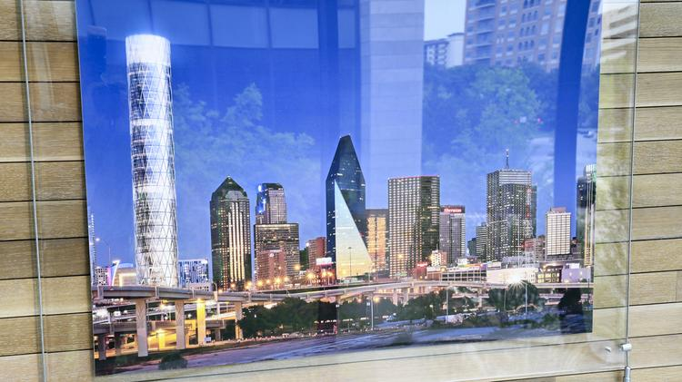 """All we need is a client"" said Perot, to build a concept building shown in a photo rendering of the Dallas skyline  displayed inside the headquarters."