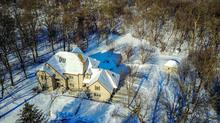 Exceptional 4 bedroom/5 bath private estate on 55 acres.