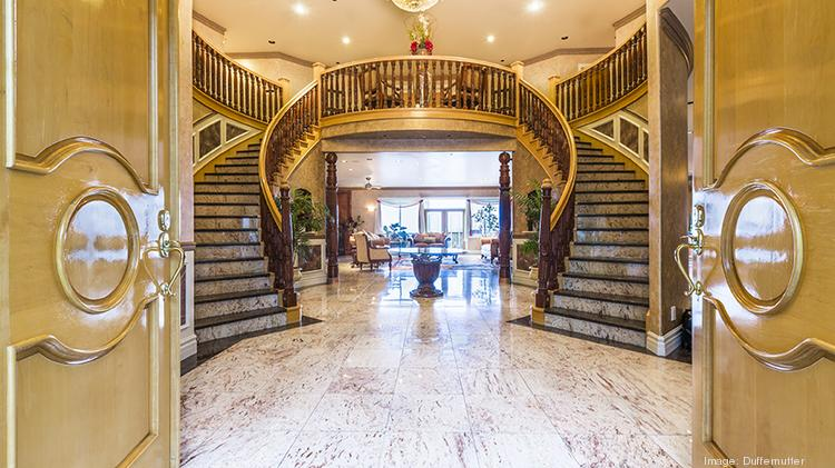Golden doors open to reveal a stunning dual staircase with hand-carved North Indian rosewood & Palatial Bollywood manse in Bellevue hits the market for $6 million ...