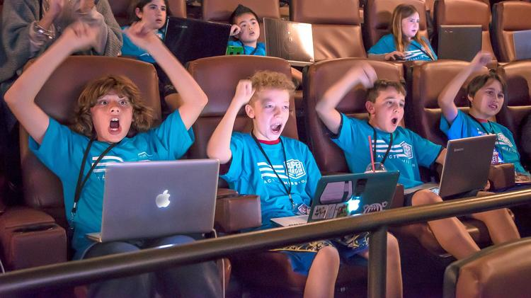 Kids cheer at the Minecraft City Champs events.