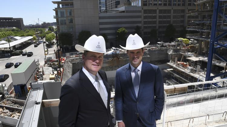 The Park District mixed-use development recently topped out near Klyde Warren Park in Uptown. Trammell Crow Co. DFW Market Director Scott Krikorian (L-R) and Joel Behrens, a principal of Trammell Crow Co., gives the Dallas Business Journal a tour of the evolving project.