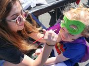 Face painting was part of the fun at the Super Hero Dash at High Point University, as were ice cream, crafts and bounce houses.