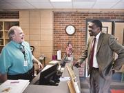 Shawn Joseph, director of Metro Nashville Public Schools, talks with substitute teacher Larry Cunningham at Rosebank STEM School in East Nashville.
