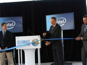 Chandler Vice Mayor Kevin Hartke (middle) cuts the ribbon to unveil Intel's solar carport installation April 20 at the Chandler campus. Marty Sedler, Intel's director of global utilities and infastructure, (left) and Carlos Contreras, Intel's regional public affairs director (right), hold the ribbon.