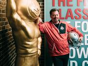 Rick Van Brimmer, Ohio State's assistant vice president of trademark and affinity management, with Brutus Buckeye, one of the school's best known trademarks