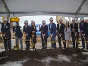 Michael Neidorff, chairman, president and CEO of Centene Corp., and Governor Eric Greitens pose for a photo with other dignitaries at Centene's Clayton expansion groundbreaking ceremony on Friday.