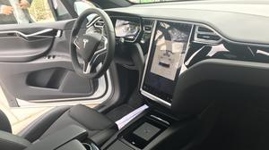 The front driver area includes a full-size screen.