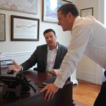 How these young investment advisers are growing their downtown Troy firm after 2 years in business
